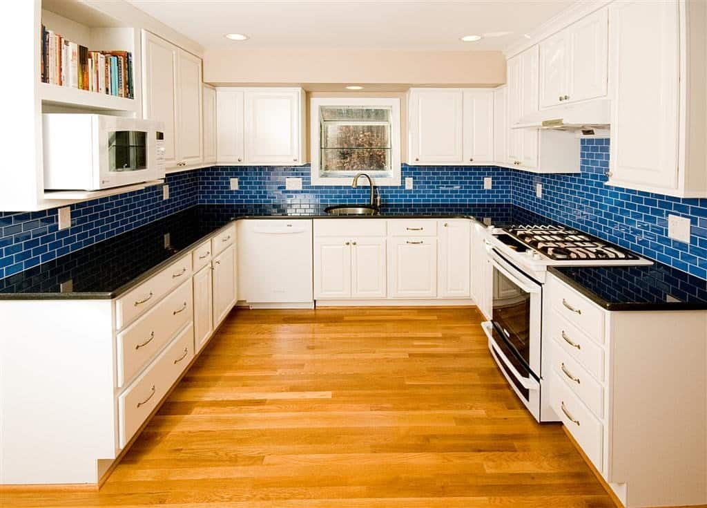 kitchen remodel with white cabinets and blue subway tile backsplash