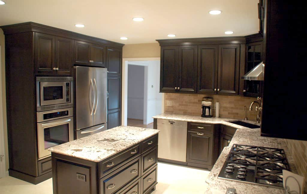 kitchen remodel with dark stain cabinets and stainless steel appliances