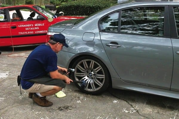 David Lonadier of Lonadier's Mobile Detail of Rosewell, travels to a customer's home to do an intricate, eco-friendly car detail.  (Photo courtesy of David Lonadier)