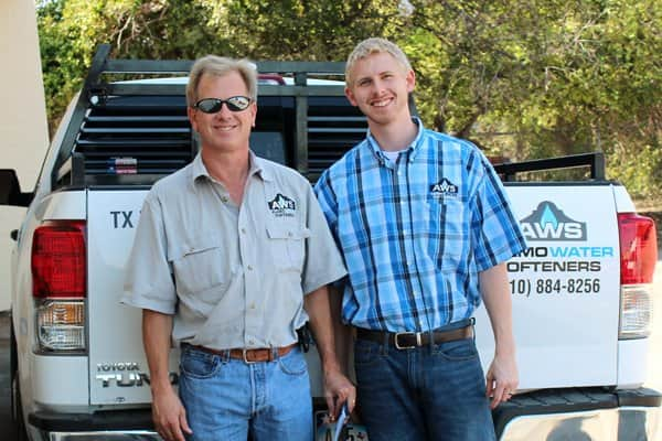 Father and son Allen and Trevor Townsend install locally-built water softeners in San Antonio. (Photo courtesy of Alamo Water Softeners)