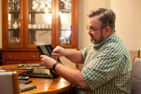 Computer Geeks owner Ryan Hitzeroth offers services ranging from motherboard replacement to data recovery to virus removal. (Photo by Meredith Rizzo)