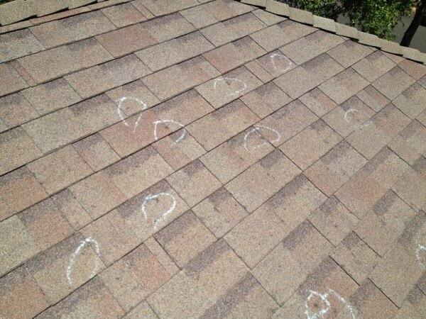 Roofing contractors use circles to mark places where hail damaged a roof. (Photo courtesy of Radiant Roofing)