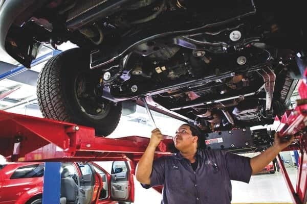 Photos by Brandon Smith | Mechanics Jon Schilling (left) and Josh Blong perform maintenance on separate vehicles at A-rated O'Brien Toyota Scion on North Shadeland Avenue in Indianapolis