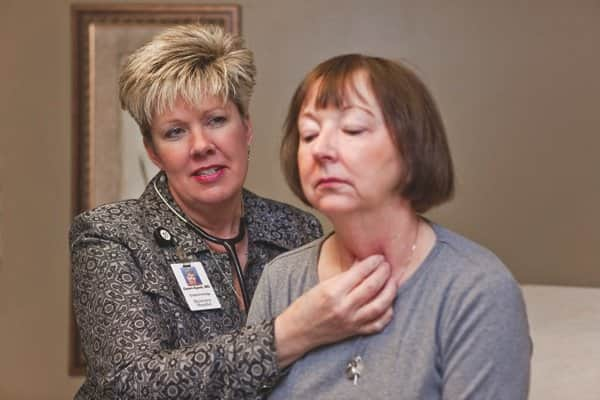 Dr. Dawn Ayres, with patient Mary Lake of Noblesville, encourages lifestyle changes in addition to self-care — such as an insulin regimen where appropriate — to properly manage diabetes. (Photo by Brandon Smith)