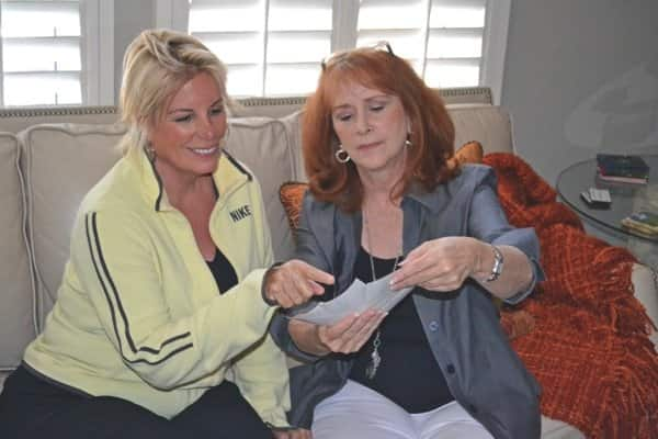 Interior designer Deborah Goodacre (right) looks at paint samples with client Suzie Douglas. (Photo courtesy of Deborah Goodacre)