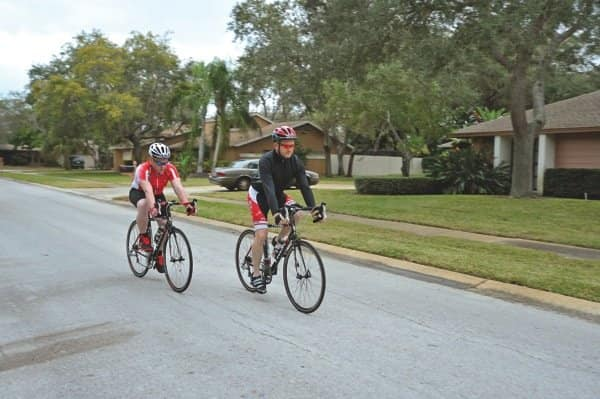 Joe Haynes (right), with his son Brian, says riding his bike has helped lower his blood pressure. (Photo by John Zambito)