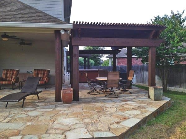 A new pergola and stone addition expanded outdoor hangout space at this Pflugerville home. (Photo courtesy of Mitch Williams)