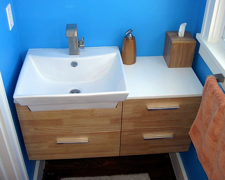 half bath remodel with blue painted interior walls