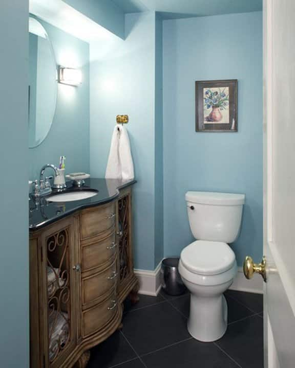 basement bathroom with blue interior wall color