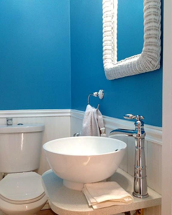 blue bathroom with white fixtures