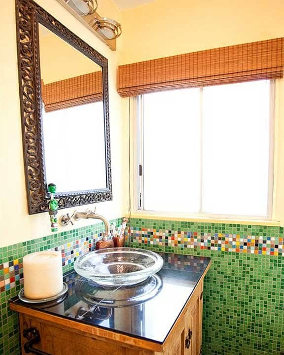 bathroom with multi-colored tiles
