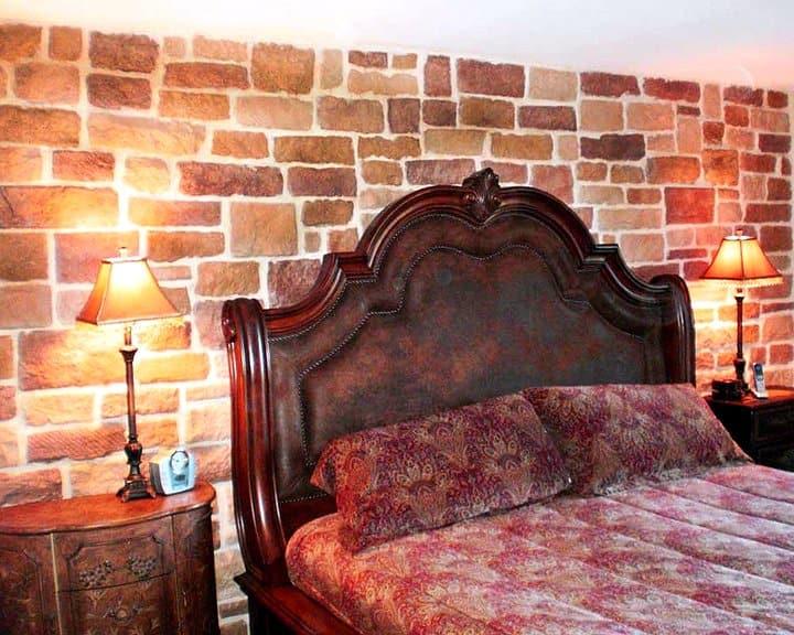 bedroom design with stone facade wall
