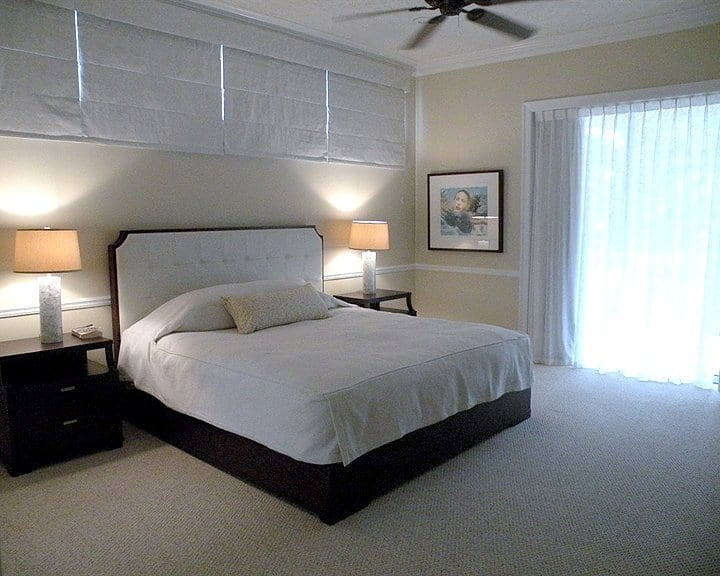 bedroom with drapes and roman shades