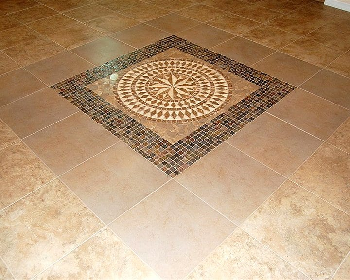 stone rosette inlaid in ceramic tile floor