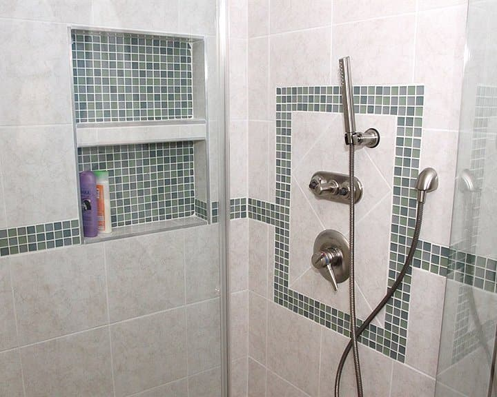 shower stall with ceramic tile design and mosaic tile