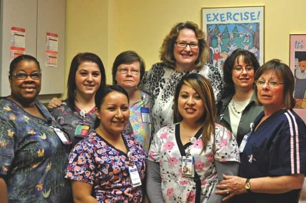 Dr. Lorene Eckberg (top, third from right) says the clinic's staff excels at patient-centered care. (Photo courtesy of Dreyer Medical Clinic — Fox Valley Villages)