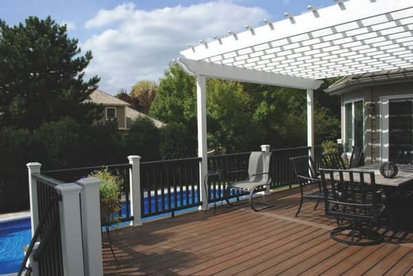 Experts say composite decking is good around pools and spas because the material does not rot. (Photo by Slamans Construction)
