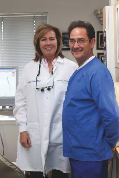 Dr. Kathleen Dillon and Dental Assistant Larry Salyer work as part of the Fusion Dental team to offer patients multi-specialty services. (Photo by Meredith Rizzo)
