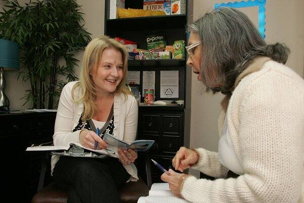 Registered dietitian Amber Bryant (left) counsels patient Kathy Spears on food intake and weight control. (Photos by Gary Kazanjian)