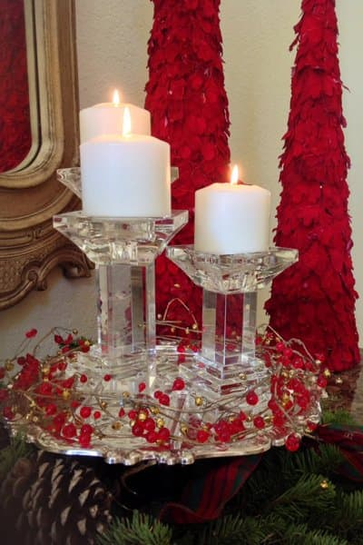 Whether they are grouped in centerpieces or as a stand-alone, remember to vary the heights of candles for visual interest, says Marsh. (Photo courtesy of Kathryn Interiors, Inc.)