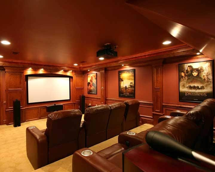 home theater with projection screen and seating for eight