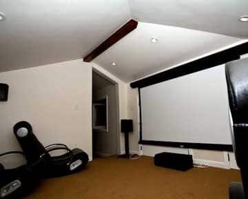 home theater with drop-down screen