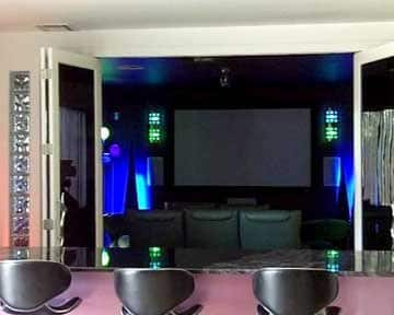 home theater with bar area