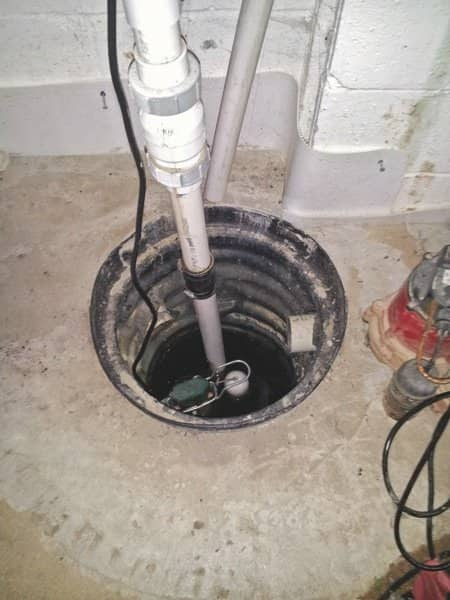Maintaining basement sump pumps keeps them in working order. (Photo courtesy of Quality Control Plumbing)