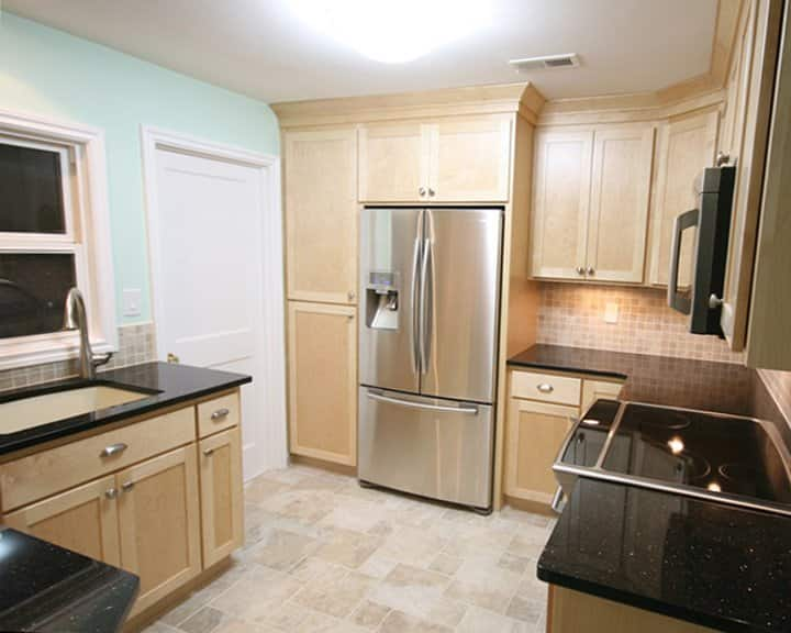 remodeled kitchen with new cabinets and countertops