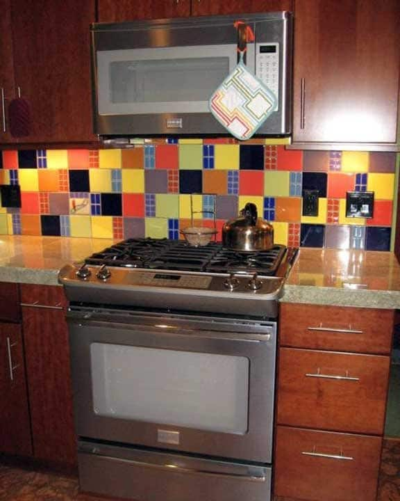 cherry cabinets with colorful tile backsplash