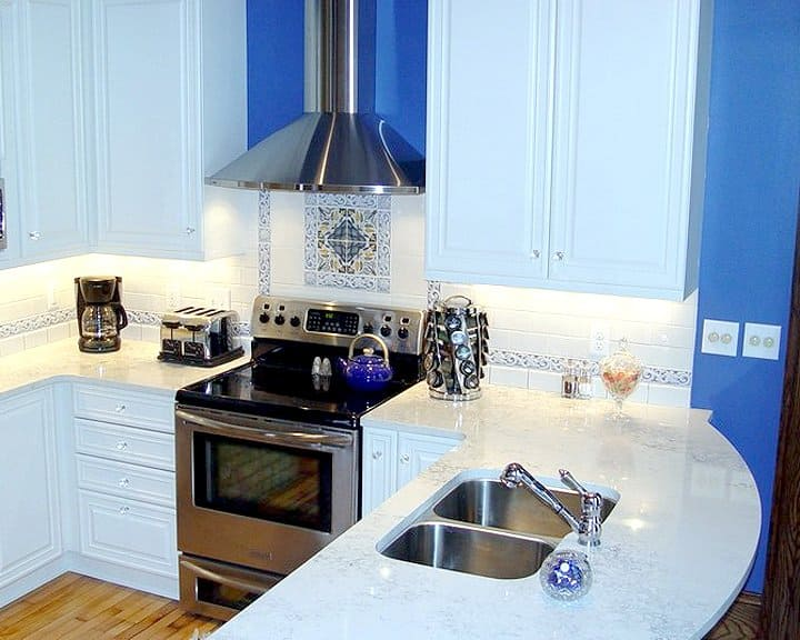 kitchen remodel with blue interior wall and white cabinets and appliances