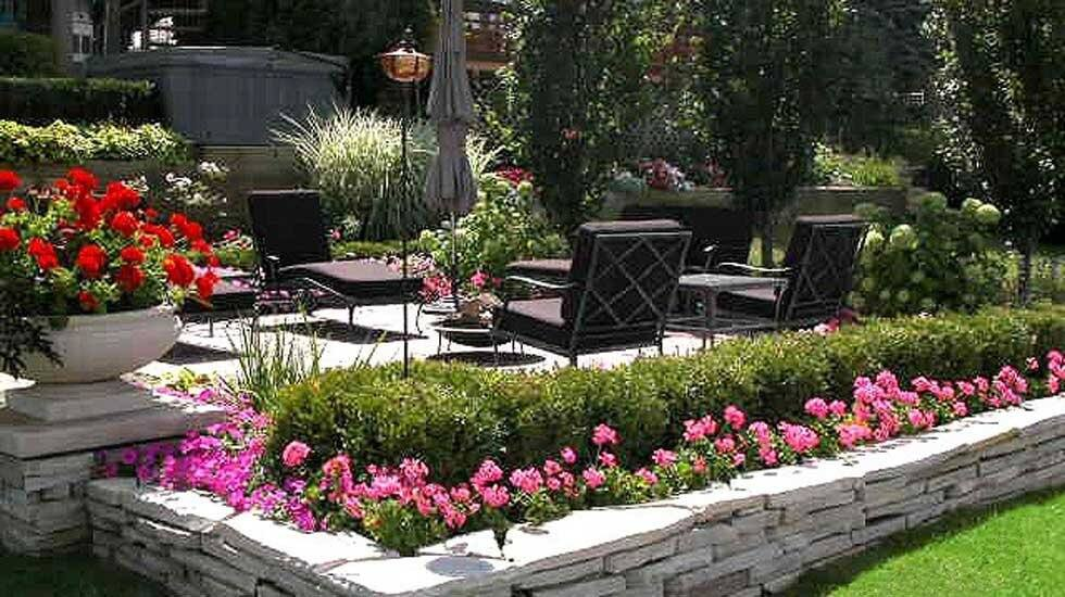 backyard landscaping with patio and planted flowers