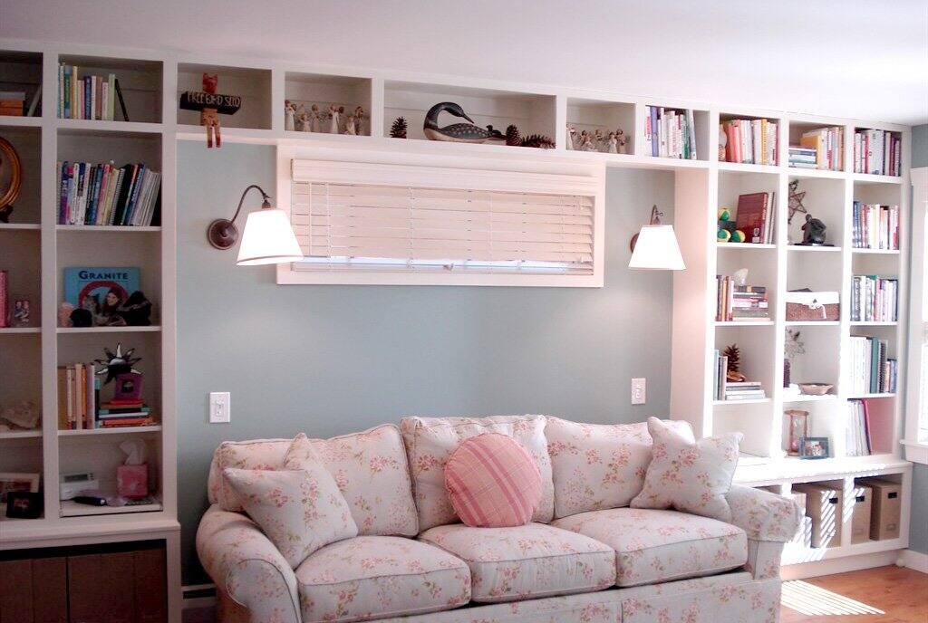 bookshelves extending over couch