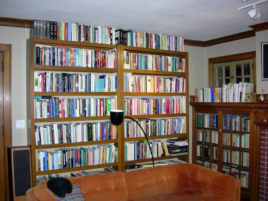 floor-to-ceiling bookselves flanking a wall in home library