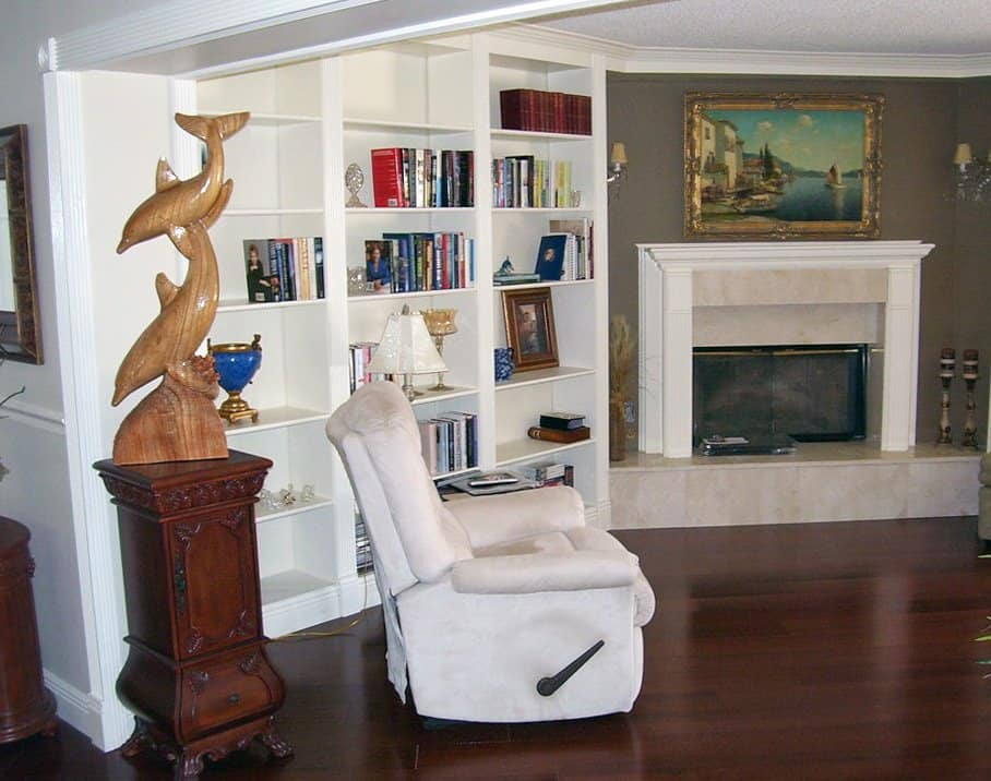 home library with built-in bookshelves