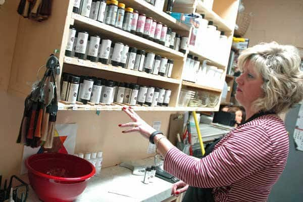 Deborah Foster, a stylist at highly rated Bab and Company in Carmel, peruses her supplies before custom-mixing a client's color. (Photo by Katie Jacewicz)