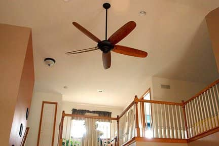 Setting the ceiling fan to operate in a clockwise direction can help circulate warm air down to ground level.
