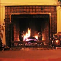 An open fireplace can suck warm air up the chimney.  Keep the flue closed when not in use.