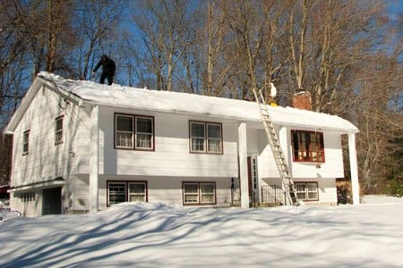 Sometimes it's necessary to remove snow accumulation from a home's roof to avoid ice dams.