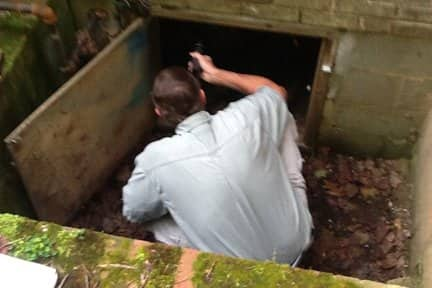 A home inspector examines a crawl space for a prospective homebuyer. (Photo courtesy of Angie's List member Charles S. of Montpelier Station, Va.)