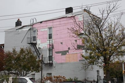 Hurricane Sandy ripped the siding from this home in Astoria, Queens. (Photo by Brandon York.)