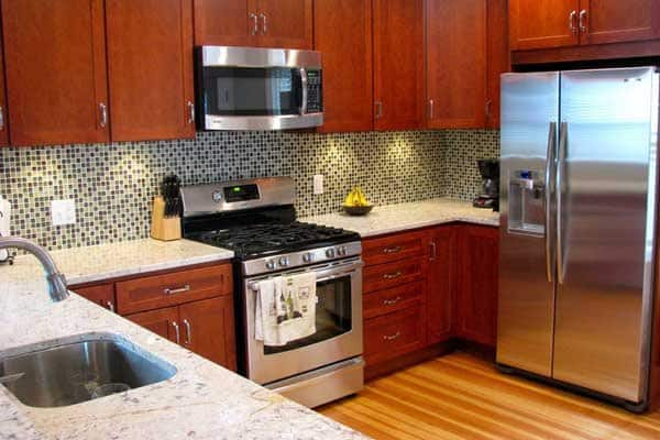 Simple changes, such as installing a tile backsplash or switching out appliances, can help makeover your kitchen and turn it into a stylish space that's functional for you and your family. (Photo courtesy of Angie's List member Joyce A. of Pittsburgh, Pa.)