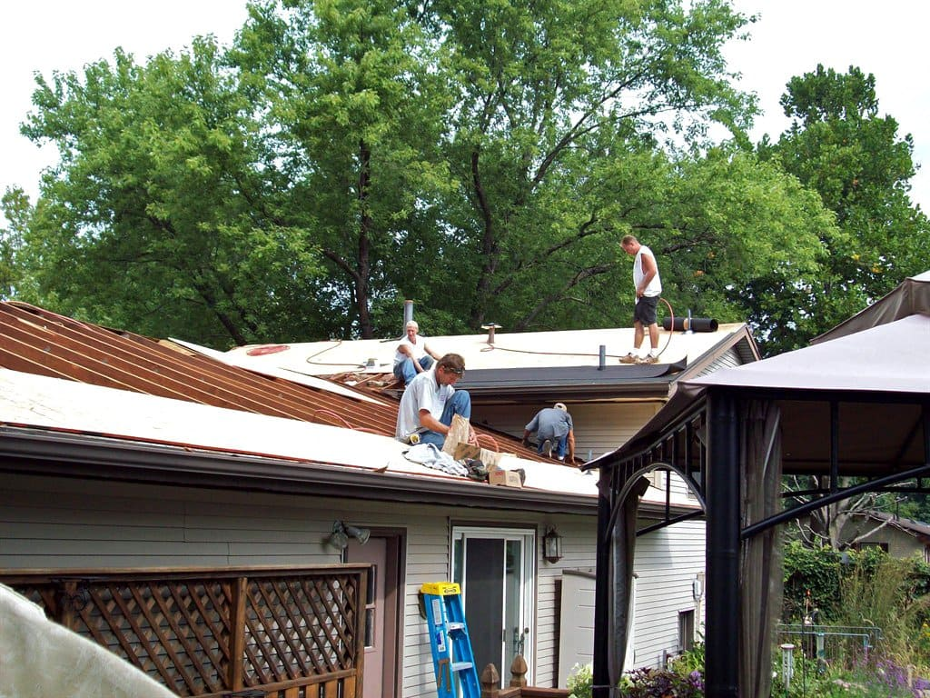 Avoid paying more by calling a professional to help maintain your roof periodically.  (Photo courtesy of Colin Kessler)