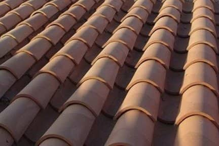 The half cylinders of tile roofing are common on Spanish Colonial and Mission styles; cement and some metal roofs imitate tile's wavy effect. All are expensive, very durable, and tend to be very heavy. (Photo courtesy of bobvila.com)