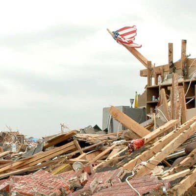 A tattered flag still waves above the rubble of a home in Moore, Oklahoma. (Photo by Katie Jacewicz)