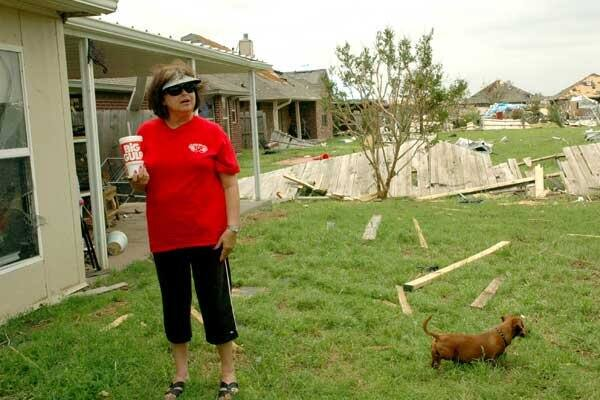 Angie's List member Valerie Kelley stands in her backyard and looks at the damaged caused by the EF5 tornado that hit her Oklahoma City home on Monday, May 20. (Photo by Katie Jacewicz)