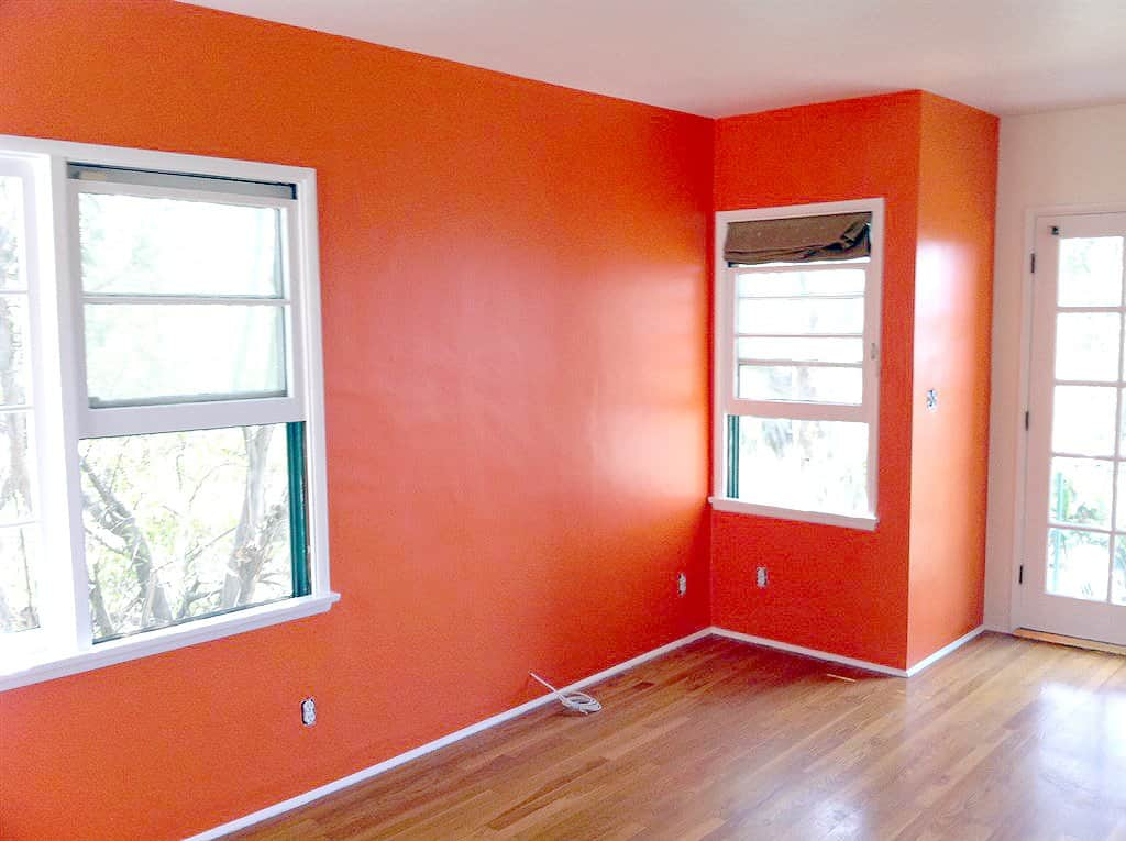 living room with orange painted walls