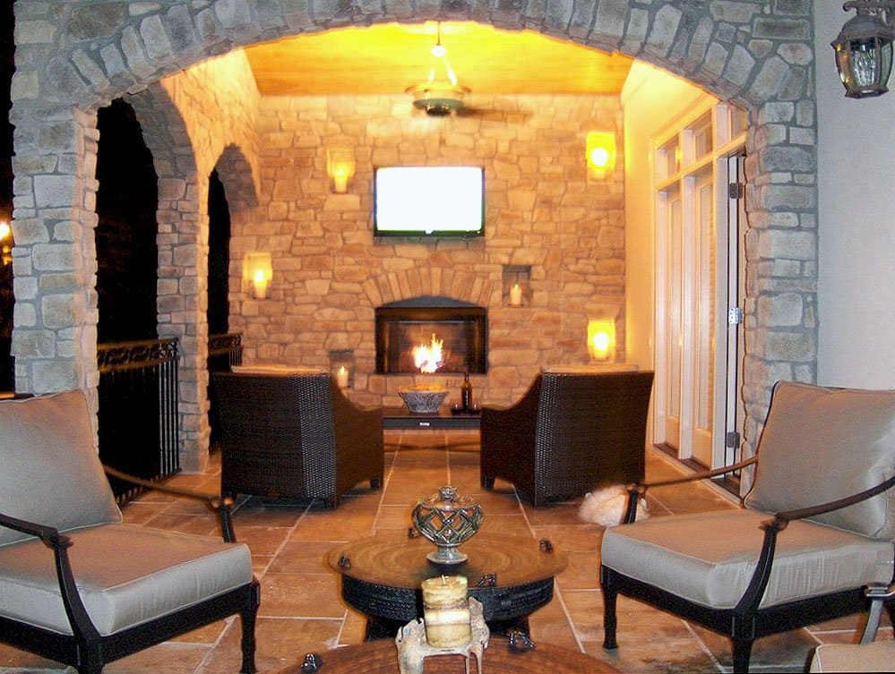 outdoor living area with outdoor fireplace and outdoor seating
