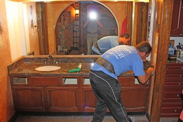 Mirage employee Vasile Maris does the finishing touches after a countertop installation. (Photo courtesy of BJ Balog)