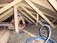 Dutch's Mold Inspection works to improve ventilation in a client's attic. Photo courtesy of Rick Nesselhauf